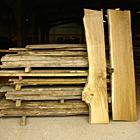 Waney edge boards of brown oak